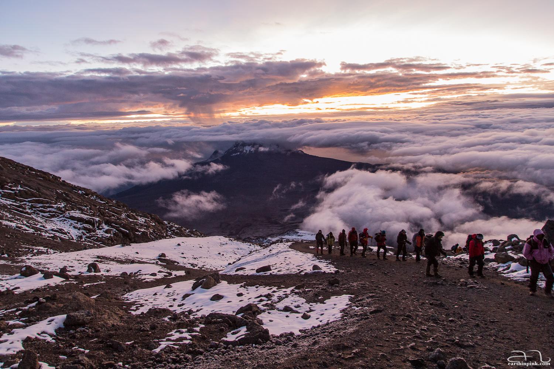 Hiking up to the Uhuru peak of Mt. Kilimanjaro (5895m) at the break of dawn
