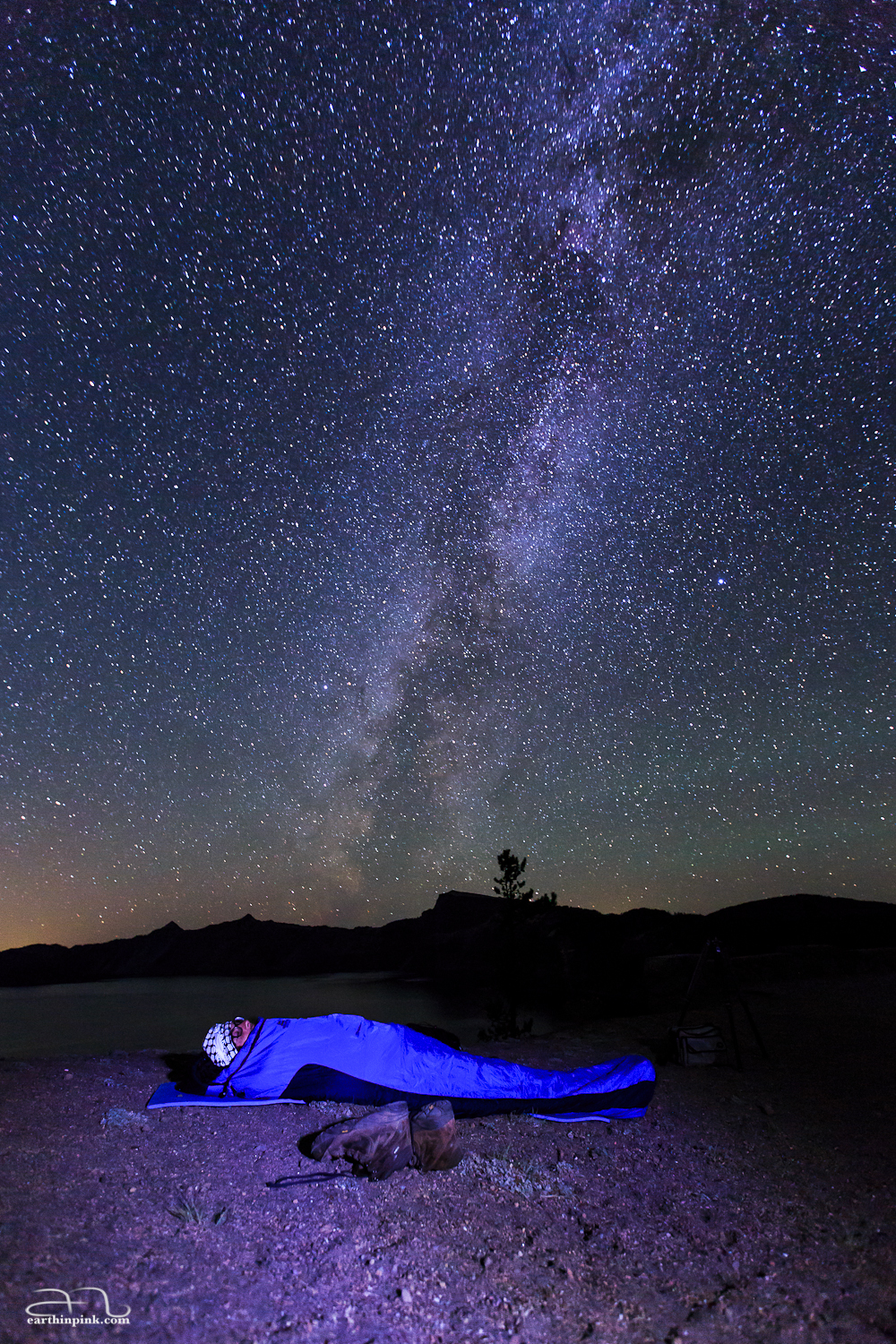 Fellow astrophotographer Karim Iliya watching the stars from the warmth of his sleeping bag after boldly leaving his rather expensive camera out in the woods to shoot a time lapse.