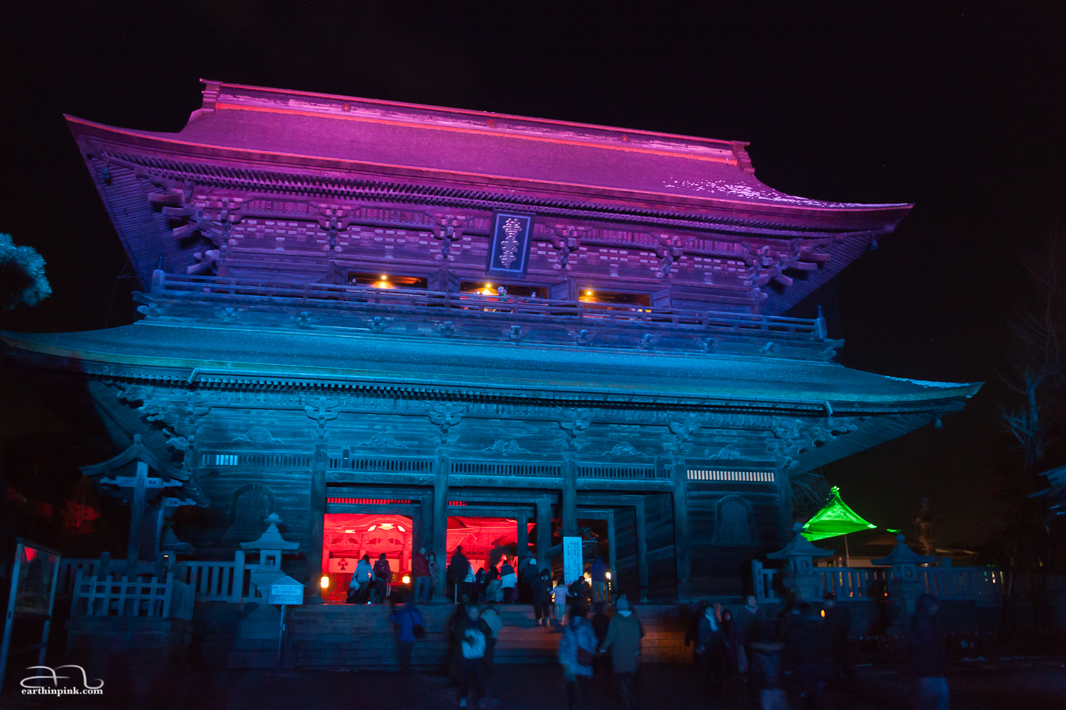 Ancient temple in Nagano, Japan, illuminated by modern lights