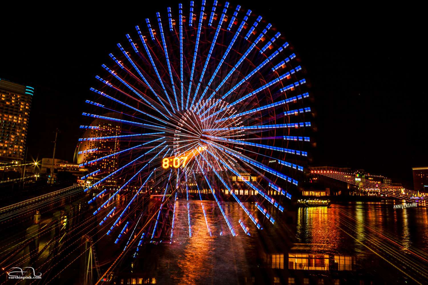 I love how the image of the Ferris wheel seems to dip down into the water on the lower side.