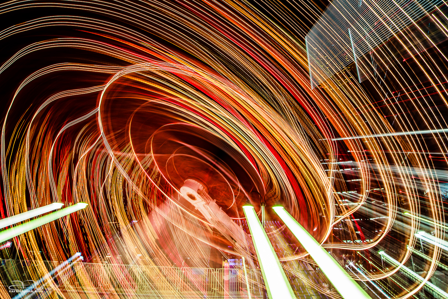A long exposure of an amusement ride at the Yokohama Cosmo World. Again, I zoomed in while the shutter was open to make this look like a whirlpool of light.