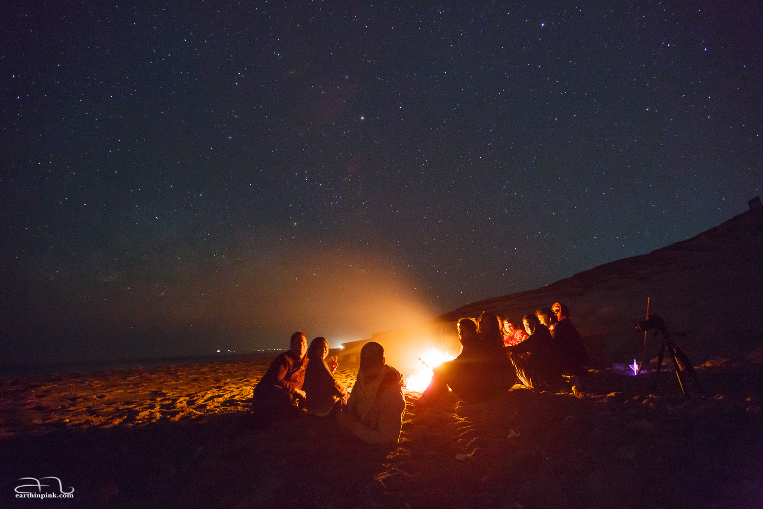 Our group from the Tokyo Snow Club enjoying the approach of summer with a bonfire under the starry sky.