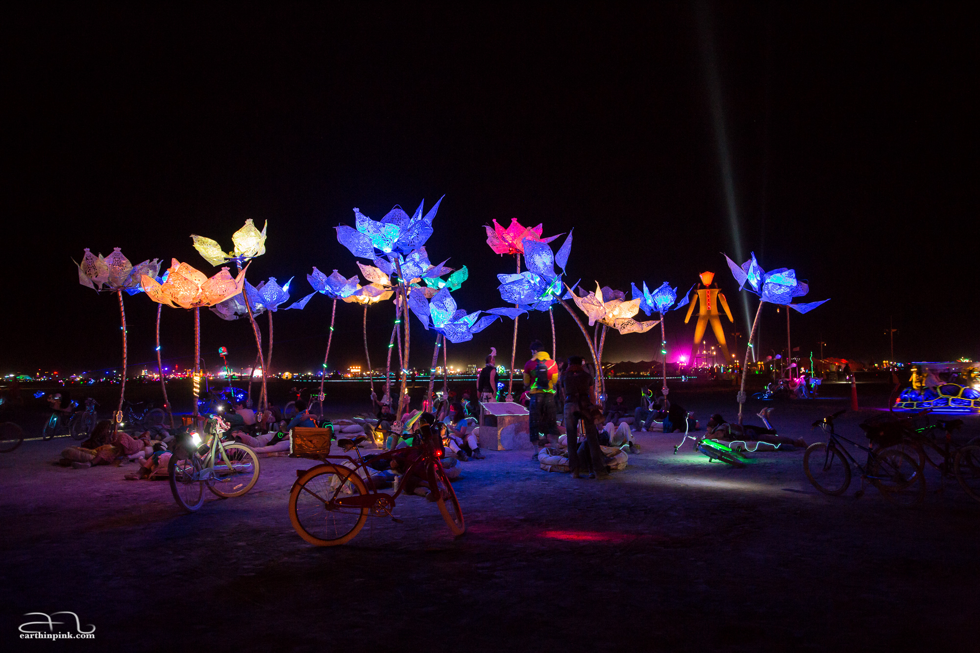 """""""Pulse and Bloom"""" - each of these 25 lotus flowers has a pulse sensor that, when pressed by a participant, translates their heartbeat into flashing LED lights within the lotus."""