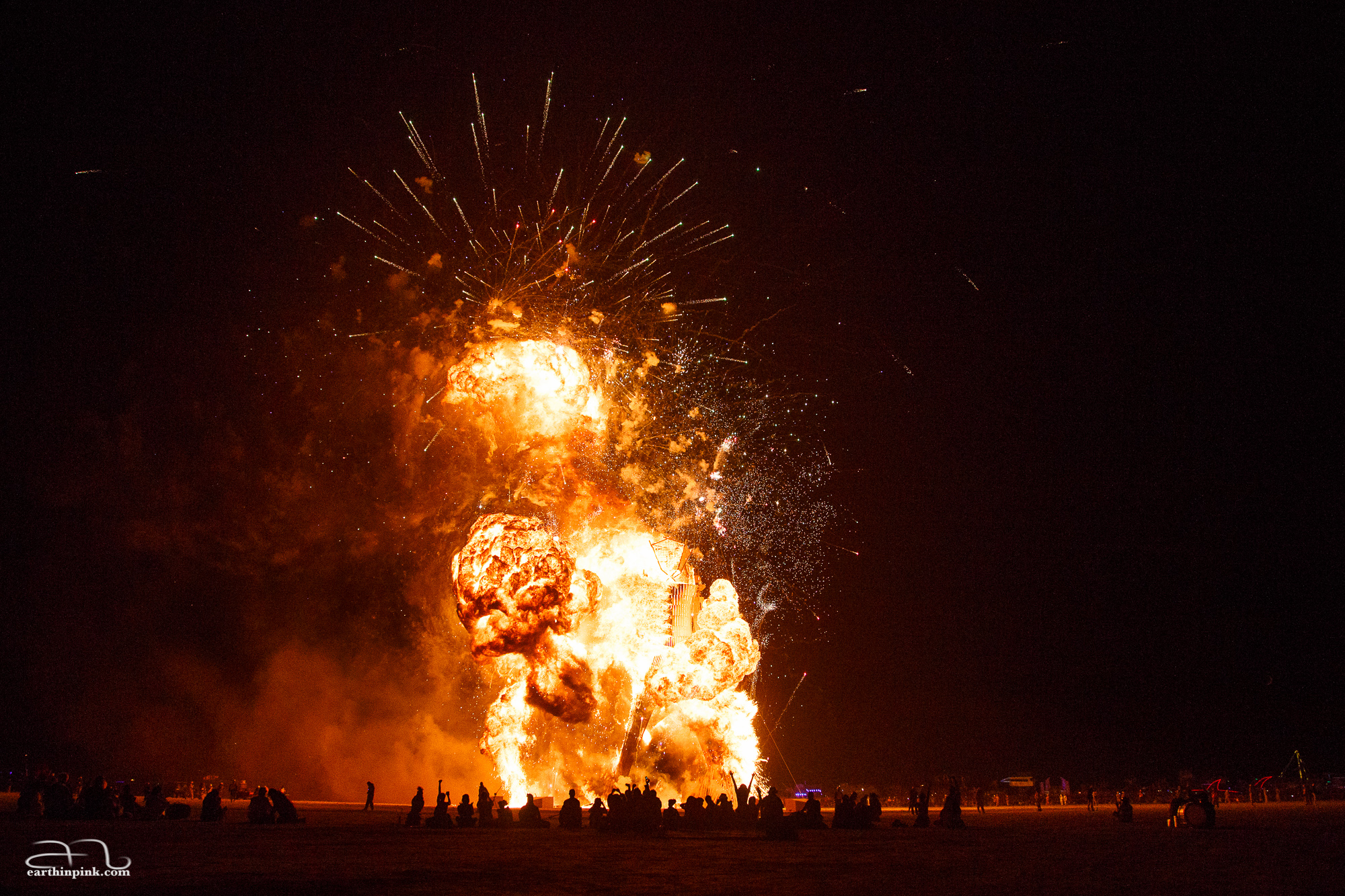Burning Man 2014 - fireworks in the background, and fire from the Man rising up in a big mushroom cloud.
