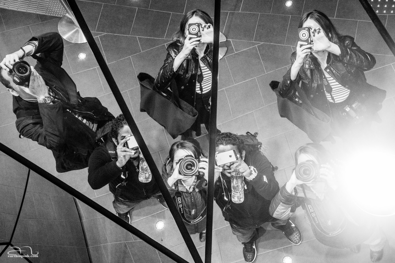During a night photography meet-up in Harajuku, our assignment was to take portraits of strangers - but when we reached this mall entrance covered with mirrors, we couldn't help but pause for a group selfie.