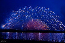Fireworks launched just above the surface of the ocean during the Kamakura Fireworks Festival 2014.