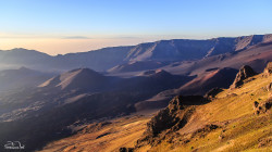 Sunrise at the summit of the Haleakala volcano (about 10,000 ft). In the distance, you can see the peaks of Mauna Kea and Mauna Loa on the Big Island of Hawaii.