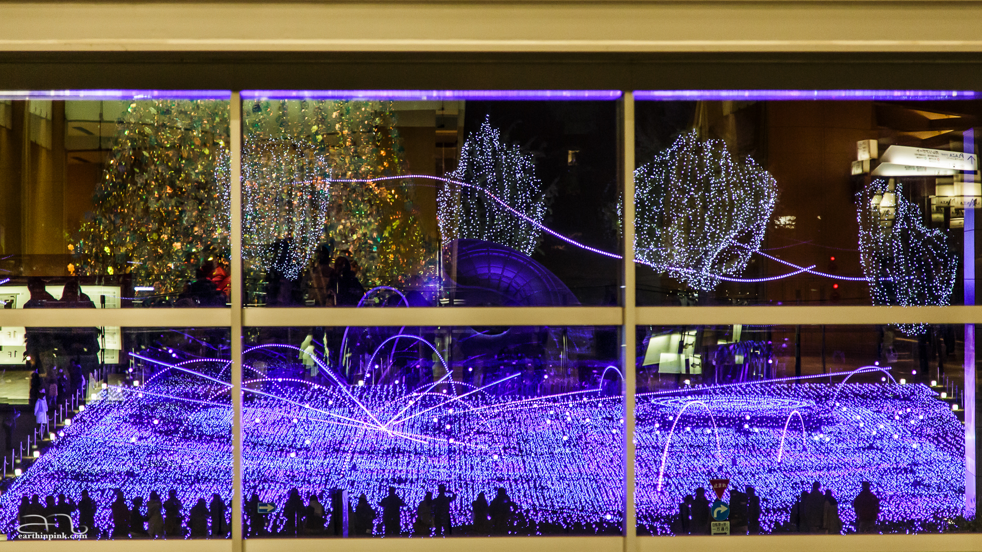 Tokyo Midtown Illumination in Roppongi - a carpet of LEDs the size of a football field, seen through a window of a nearby mall. If you look closely, you'll see both the inside of the mall reflected in the glass and the illumination outside.