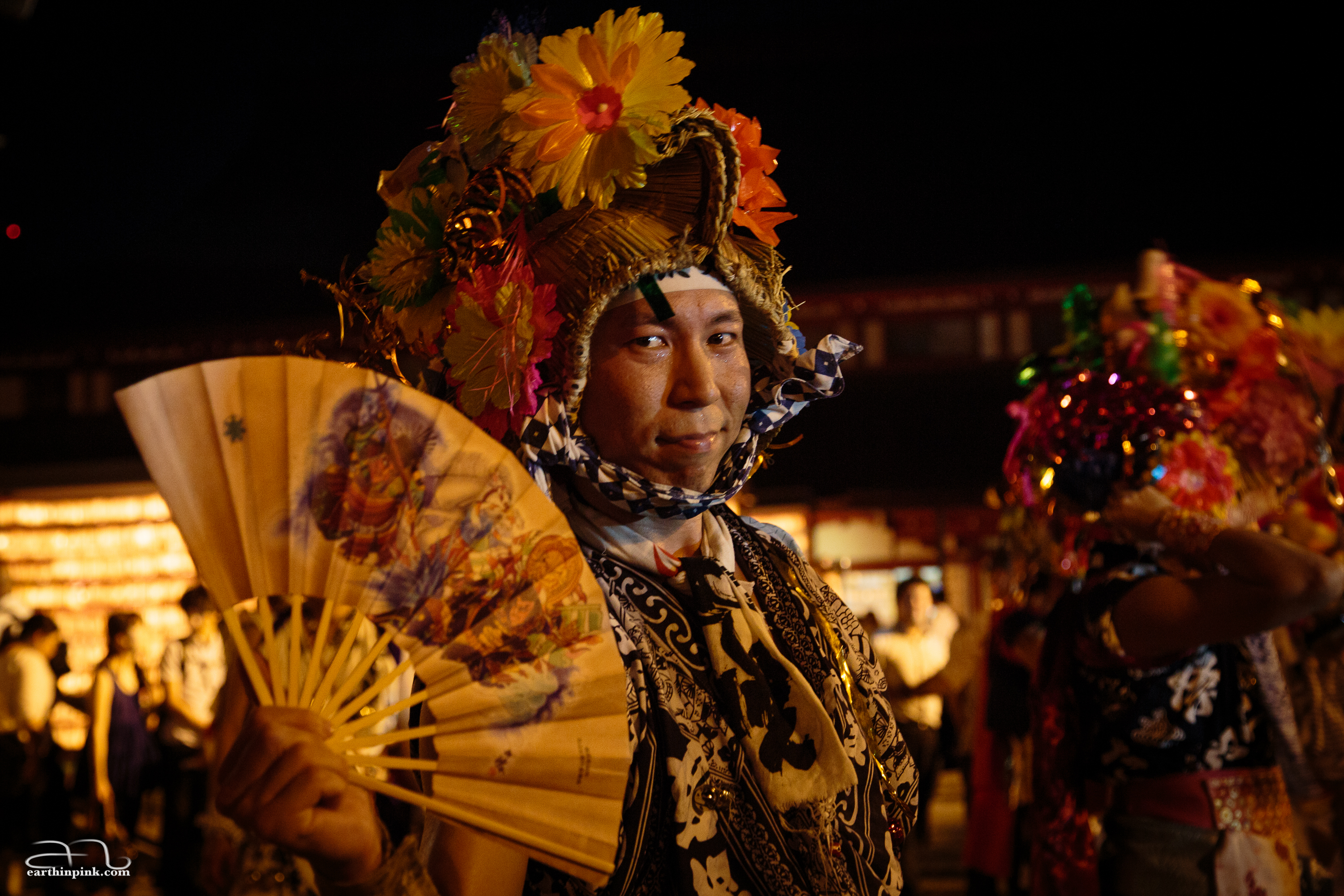 One of the participants in the festival's parade poses for the camera for just a split second.