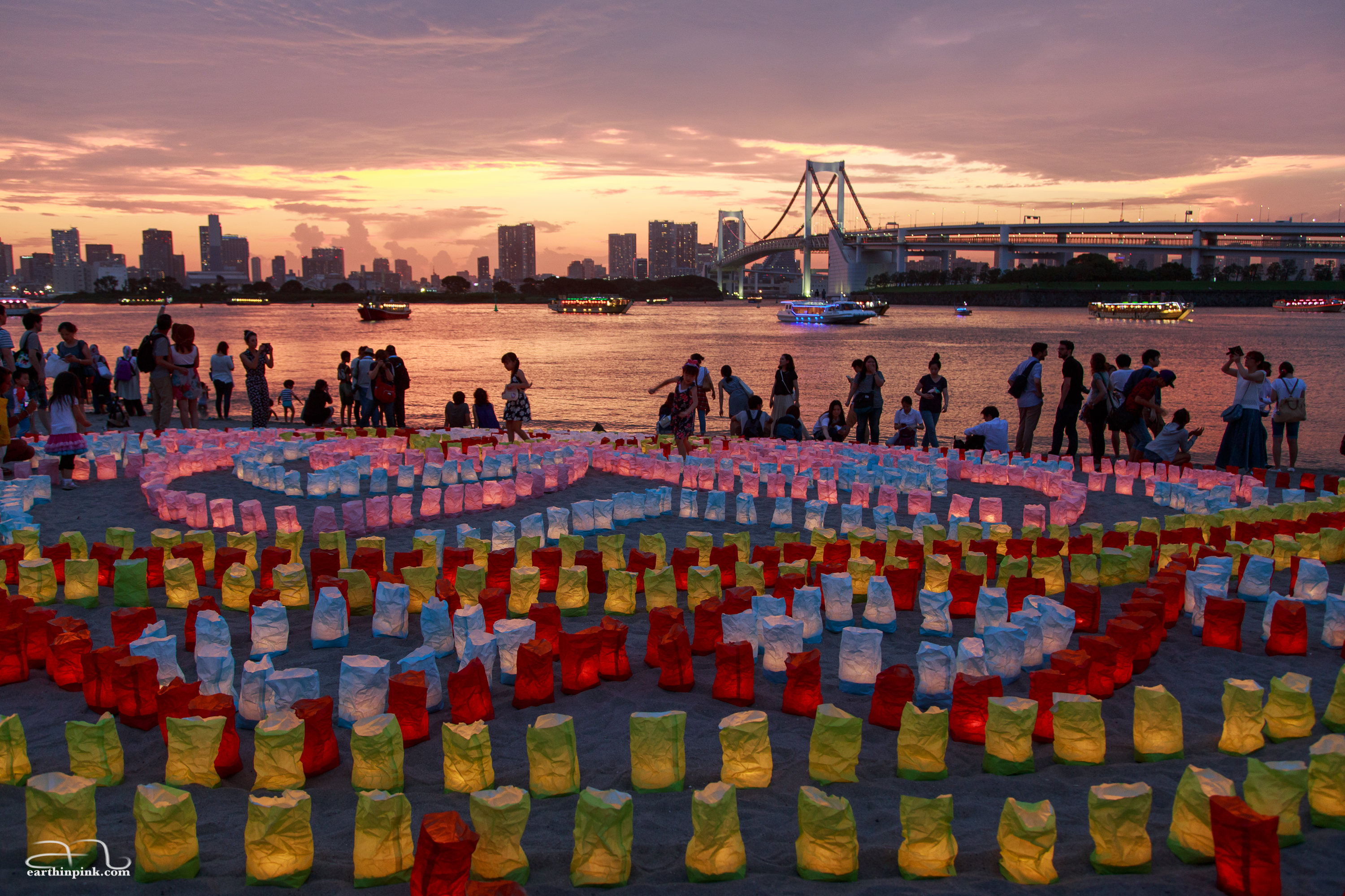 Hundreds of paper lanterns arranged by volunteers on Odaiba beach to celebrate Umi no hi (ocean day) on the third Monday in July.